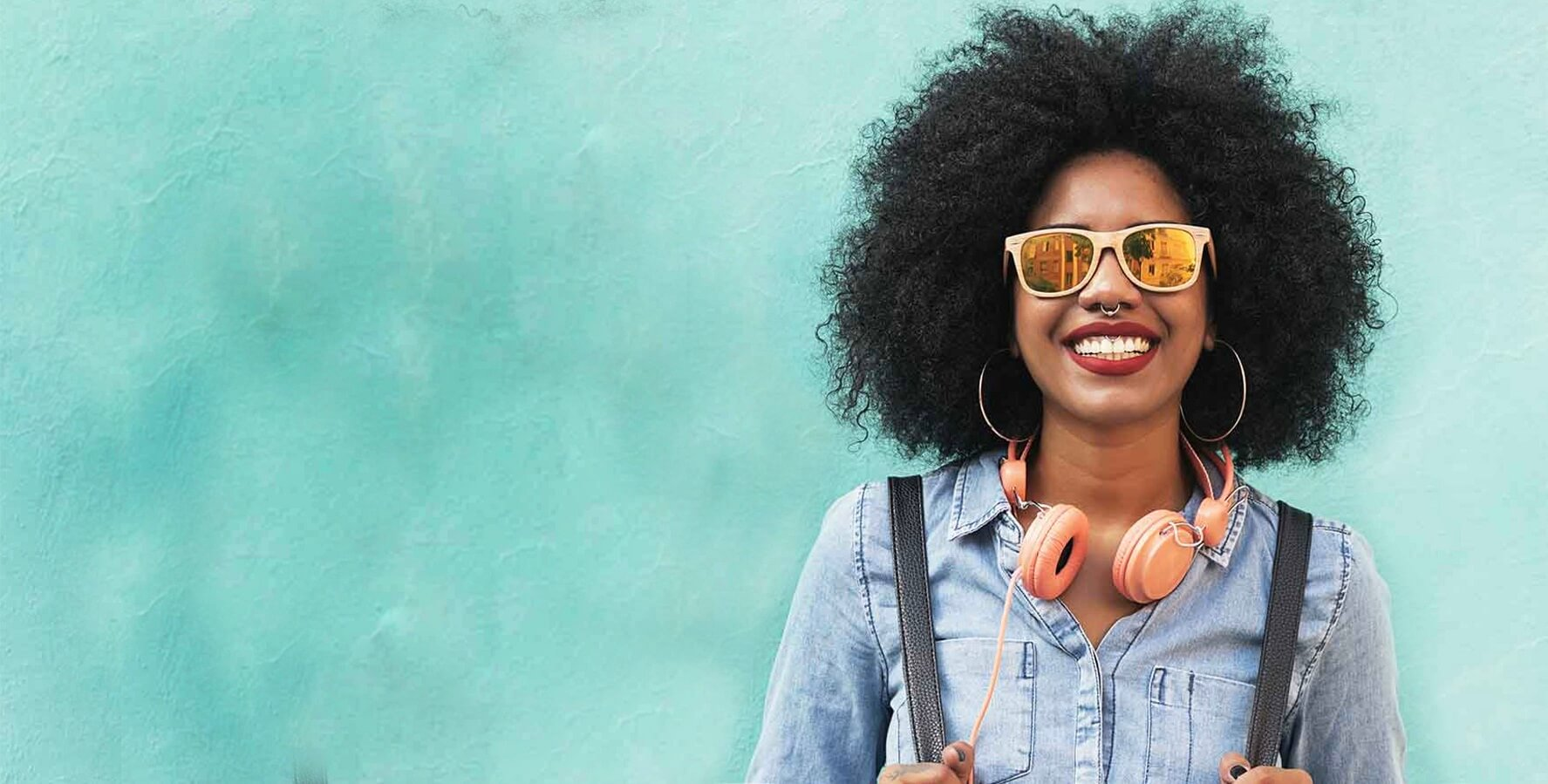 woman in sunglasses with headphones